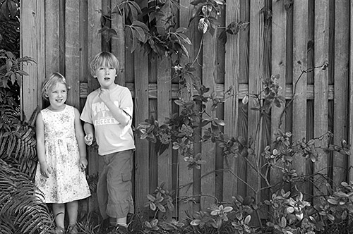 Ben and Lucy by a Fence